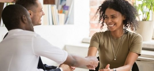 female shaking hands with new coworker before onboarding