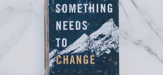 What is change management? This is reflected by a book cover that reads Something Needs To Change